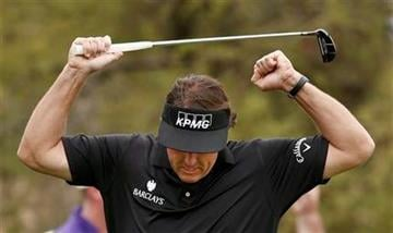 Phil Mickelson pumps his arms as he celebrates a long birdie putt on the seventh hole during the final round of the Waste Management Phoenix Open golf tournament on Sunday, Feb. 3, 2013, in Scottsdale, Ariz. (AP Photo/Ross D. Franklin) By Ross D. Franklin