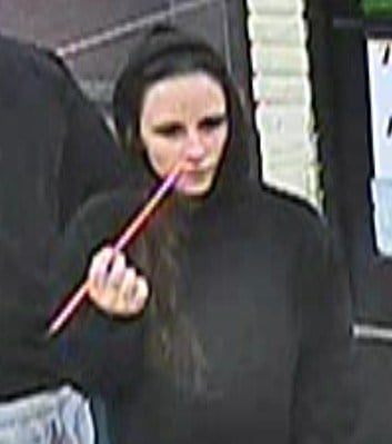The woman, who was not involved in the robbery, is 5 feet 8 inches tall, weighs about 140 pounds and has long brown hair. By Catherine Holland