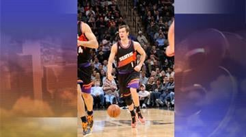 Goran Dragic #1 of the Phoenix Suns moves the ball up-court against the San Antonio Spurs on February 27, 2013, at the AT&T Center in San Antonio, Texas. By Jennifer Thomas