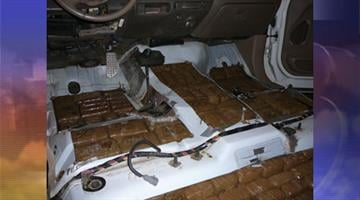 Tucson Sector Border Patrol agents arrested a suspected drug smuggler and seized nearly 1,500 pounds of marijuana concealed in false compartments in a pickup truck. By Jennifer Thomas