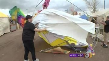 Strong winds blew down tents at the Ostrich Festival in Chandler, Ariz. on Friday afternoon and forced organizers to shut down the event for a few hours. By Mike Gertzman