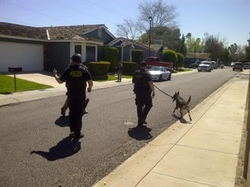 Officers searched neighborhoods near the north Phoenix U.S. Bank that was robbed Tuesday. By Mike Gertzman