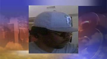 Surveillance photo of suspect who robbed the Bank of America at Alma School and Elliot roads By Jennifer Thomas
