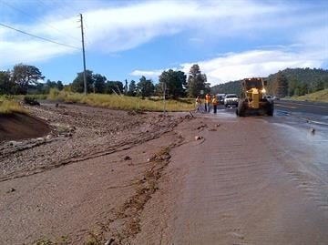 Before receding, floodwaters from the Sept. 12, 2012 monsoon storm extended into the two southbound lanes of US 89, requiring the closure of one southbound lane for several hours near the intersection with Brandis Way. By Mike Gertzman