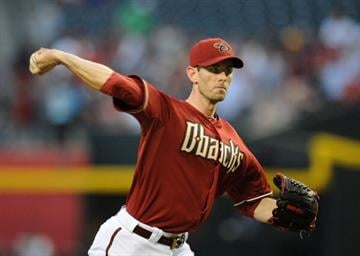 PHOENIX, AZ - APRIL 03:  Brandon McCarthy #32 of the Arizona Diamondbacks delivers a pitch in the first inning against the St Louis Cardinals at Chase Field on April 3, 2013 in Phoenix, Arizona.  (Photo by Norm Hall/Getty Images) By Norm Hall