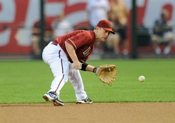 PHOENIX, AZ - APRIL 03:  Aaron Hill #2 of the Arizona Diamondbacks makes a play on a ground ball in the first inning against the St Louis Cardinals at Chase Field on April 3, 2013 in Phoenix, Arizona.  (Photo by Norm Hall/Getty Images) By Norm Hall
