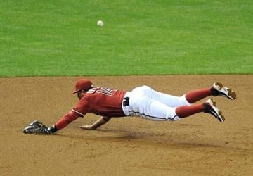 PHOENIX, AZ - APRIL 03:  Martin Prado #14 of the Arizona Diamondbacks dives but can't come up with a ground ball against the St Louis Cardinals at Chase Field on April 3, 2013 in Phoenix, Arizona.  (Photo by Norm Hall/Getty Images) By Norm Hall
