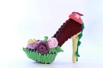 "Artist Colleen Steinberg's ""Spring Knit"" stiletto is inspired by the idea that fiber work is used and created by women of nearly every culture. Her cotton-yard knitted work is a fitting tribute to the stiletto. By Catherine Holland"