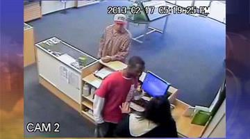 Surveillance image of both suspects By Jennifer Thomas