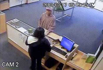 Surveillance image of suspect No. 1 By Jennifer Thomas