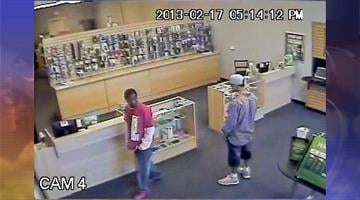 Surveillance image of both suspects By Jennifer Thomas