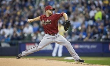 MILWAUKEE, WI - APRIL 7: Ian Kennedy #31 of the Arizona Diamondbacks pitches to a Milwaukee Brewers batter in the first inning at Miller Park on April 7, 2013 in Milwaukee, Wisconsin.  (Photo by Tom Lynn/Getty Images) By Tom Lynn