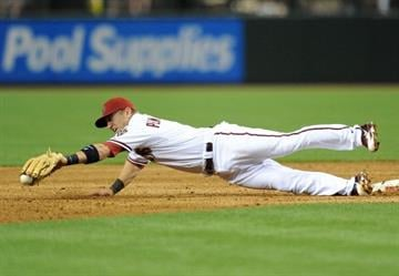 PHOENIX, AZ - APRIL 08:  Cliff Pennington #4 of the Arizona Diamondbacks dives for the ball against the Pittsburgh Pirates at Chase Field on April 8, 2013 in Phoenix, Arizona.  (Photo by Norm Hall/Getty Images) By Norm Hall