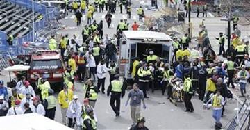 Medical workers aid injured people at the finish line of the 2013 Boston Marathon following an explosion. (AP Photo/Charles Krupa)