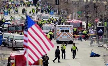 Emergency workers aid injured people at the finish line of the 2013 Boston Marathon following an explosion in Boston, Monday, April 15, 2013. (AP Photo/Charles Krupa) By Charles Krupa