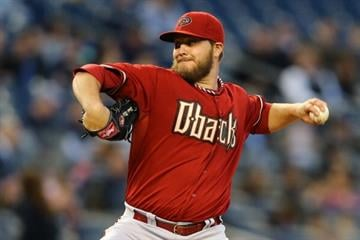 NEW YORK, NY - APRIL 17:  Wade Miley #36 of the Arizona Diamondbacks pitches against the New York Yankees during their game on April 17, 2013 at Yankee Stadium in the Bronx borough of New York City  (Photo by Al Bello/Getty Images) By Al Bello