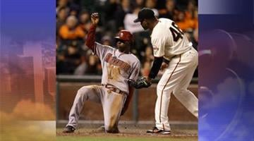 Arizona Diamondbacks' Didi Gregorius, left, scores past the tag of San Francisco Giants pitcher Santiago Casilla in the eleventh inning of a baseball game Tuesday, April 23, 2013, in San Francisco. Gregorius scored on a wild pitch from Casilla.
