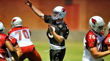 Quarterback Carson Palmer delivers a pass during a minicamp practice Tuesday. By Catherine Holland