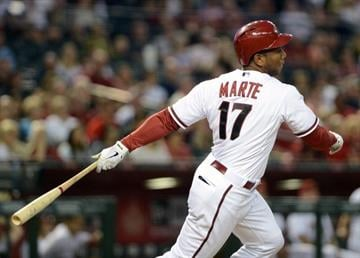 PHOENIX, AZ - APRIL 26:  Alfredo Marte #17 of the Arizona Diamondbacks hits an RBI single against the Colorado Rockies in the second inning at Chase Field on April 26, 2013 in Phoenix, Arizona.  (Photo by Jennifer Stewart/Getty Images) By Jennifer Stewart