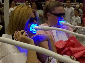 A group of women getting their teeth whitened at Arizona's Ultimate Women's Expo By Content Creator
