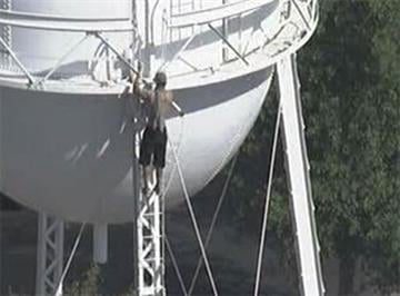 Man on Gilbert water tower near Gilbert and Elliot roads By Jennifer Thomas
