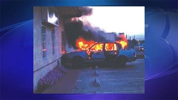 A vehicle burns by a medical marijuana dispensary in Kingman. By Jennifer Thomas