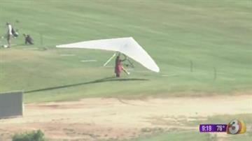 Hang glider lands at Cave Creek Golf Course near 19th Avenue and Greenway Road in Phoenix. By Jennifer Thomas