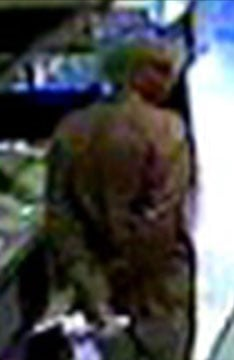 Photo captured from surveillance video of suspect By Jennifer Thomas