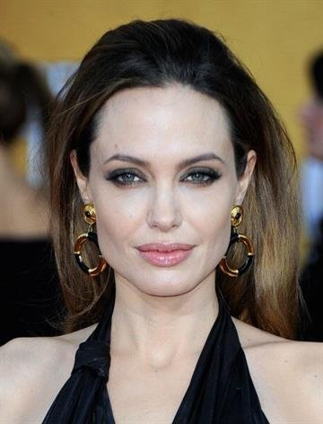 LOS ANGELES, CA - JANUARY 29:  Actress Angelina Jolie arrives at the 18th Annual Screen Actors Guild Awards at The Shrine Auditorium on January 29, 2012 in Los Angeles, California.  (Photo by Frazer Harrison/Getty Images) By Frazer Harrison