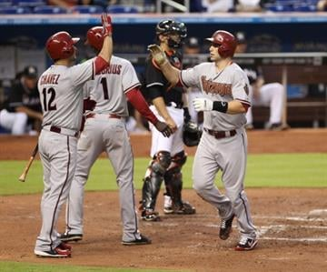 MIAMI, FL - MAY 17: Paul Goldschmidt #44 (R) of the Arizona Diamondbacks celebrates a two run home run in the third inning against the Miami Marlins at Marlins Park on May 17, 2013 in Miami, Florida. (Photo by Marc Serota/Getty Images) By Marc Serota