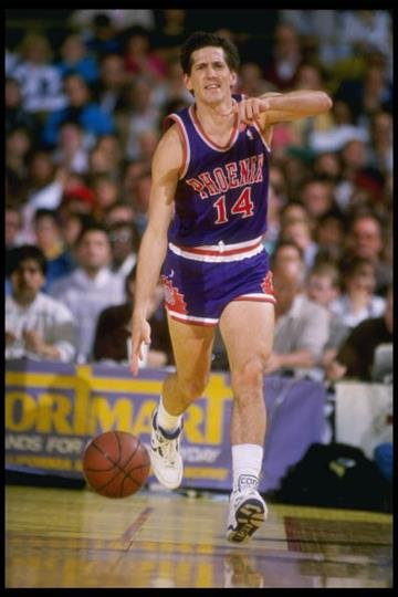 1988-1989:  Guard Jeff Hornacek of the Phoenix Suns moves the ball during a game. Mandatory Credit: Stephen Dunn  /Allsport By Stephen Dunn