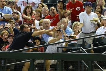 PHOENIX, AZ - JUNE 23: Fans try to catch a foul ball during a game between the Arizona Diamondbacks and the Cincinnati Reds at Chase Field on June 23, 2013 in Phoenix, Arizona. (Photo by Norm Hall/Getty Images) By Norm Hall