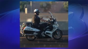 A 3TV viewer took a picture of a Tempe police officer allegedly texting while riding his motorcycle on U.S. 60. By Jennifer Thomas