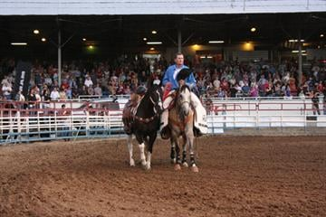 Miles Dewitt leads a riderless horse. The Prescott Frontier Days Rodeo is dedicated to the 19 fallen firefighters. By Jennifer Thomas
