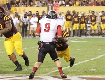 Young sacks Utah QB Jon Hays during their battle on September 22, 2012