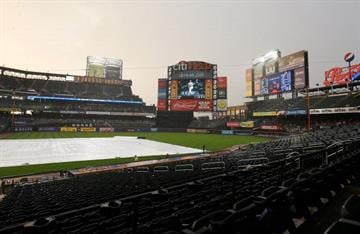 NEW YORK, NY - JULY 03:  Rain delays the start of the game between the New York Mets and the Arizona Diamondbacks on July 3, 2013 at Citi Field in the Flushing neighborhood of the Queens borough of New York City.  (Photo by Elsa/Getty Images) By Elsa