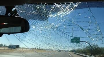 """Damage to this windshield was caused by a flying """"tire alligator"""" on June 26, 2013. The incident happened on Interstate 10 near Marana Road. The two ADOT employees inside the vehicle were shaken up, but not hurt. By Catherine Holland"""