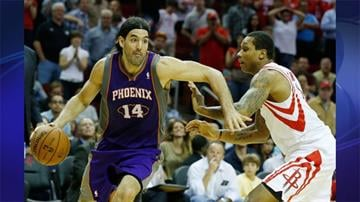 Luis Scola #14 of the Phoenix Suns drives past Greg Smith #4 of the Houston Rockets at the Toyota Center on April 9, 2013 in Houston, Texas. By Andrew Michalscheck