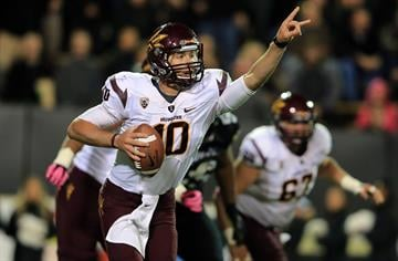 BOULDER, CO - OCTOBER 11:  Quarterback Taylor Kelly #10 of the Arizona State Sun Devils looks for a receiver against the Colorado Buffaloes at Folsom Field on October 11, 2012 in Boulder, Colorado.  (Photo by Doug Pensinger/Getty Images) By Doug Pensinger