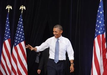US President Barack Obama arrives to speak at Desert Vista High School on August 6, 2013 in Phoenix, Arizona. AFP PHOTO/Mandel NGAN        (Photo credit should read MANDEL NGAN/AFP/Getty Images) By MANDEL NGAN