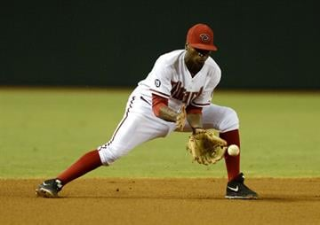 PHOENIX, AZ - AUGUST 12:  Didi Gregorius #1 of the Arizona Diamondbacks makes a play on a ground ball against the Baltimore Orioles at Chase Field on August 12, 2013 in Phoenix, Arizona.  (Photo by Norm Hall/Getty Images) By Norm Hall
