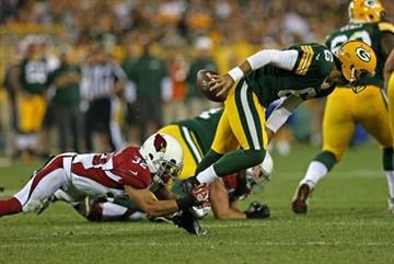 GREEN BAY, WI - AUGUST 09: Graham Harrell #6 of the Green Bay Packers is sacked by Tyrann Mathieu #35 of the Arizona Cardinals at Lambeau Field on August 9, 2013 in Green Bay, Wisconsin. (Photo by Jonathan Daniel/Getty Images) By Jonathan Daniel