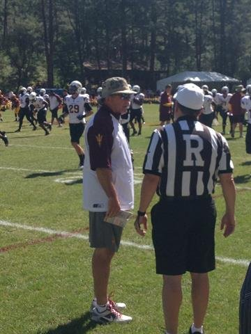 ASU head coach Todd Graham talks to a referee before Saturday's scrimmage. By Brad Denny