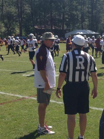 ASU head coach Todd Graham talks to a referee before Saturday's scrimmage. By Brad Denny