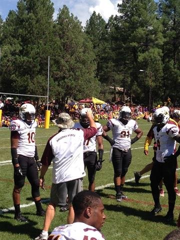 ASU head coach Todd Graham talks to the Sun Devil secondary after the defense allowed a touchdown. By Brad Denny