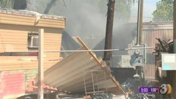 A fire damaged two mobile homes near 17th Avenue and Bell Road in Phoenix Sunday afternoon. By Jennifer Thomas