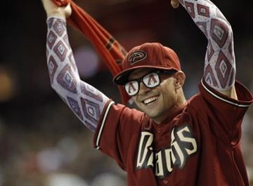 PHOENIX, AZ - AUGUST 31:  An Arizona Diamondbacks fan celebrates the team's 4-3 victory over the San Francisco Giants during a MLB game at Chase Field on August 31, 2013 in Phoenix, Arizona.  (Photo by Ralph Freso/Getty Images) By Ralph Freso