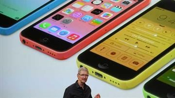 """Apple's latest iPhones will come in a bevy of colors and two distinct designs, one made of plastic and the other that aims to be """"the gold standard of smartphones"""" and reads your fingerprint. By Mike Gertzman"""