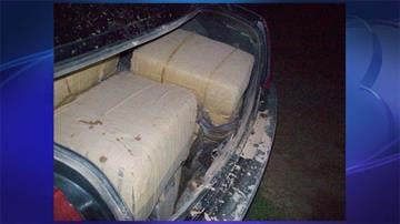 Smugglers tossed 370 pounds of marijuana into a sedan before dashing back to Mexico. By Jennifer Thomas