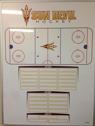 A white board in the new coach's office. By Brad Denny
